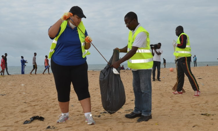 Charge d'Affaires Dana Banks helps clean waste and debris from the Lome beachfront on Sep. 10 during a beach clean-up organized by the Embassy