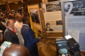 President Faure Gnassingbe, US Ambassador David Gilmour and Gilchrist Olympio visiting the stand
