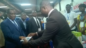 The Togolese Primer Minister receiving flyers from Educational Advisor