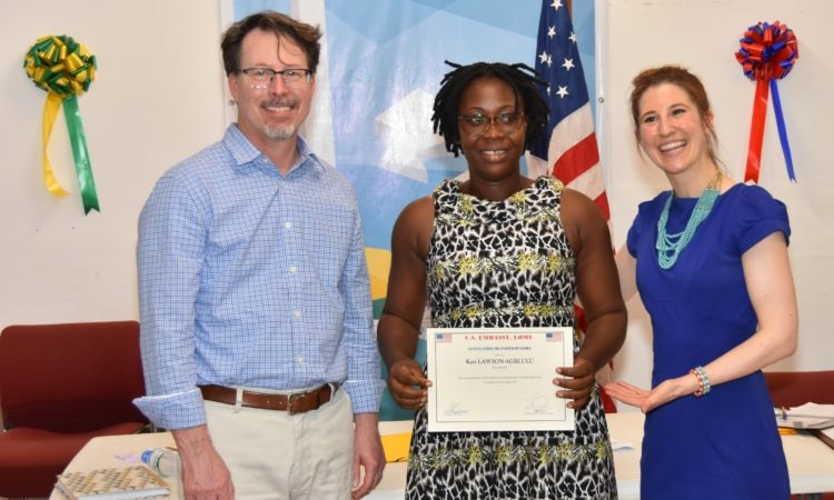 A participant receiving her certificate from Peregrine Olander and ARS director