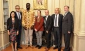 American-Togolese co-founders of Alaffia, Olowo N'Djo Tchala poses with some under secretaries of the State Department