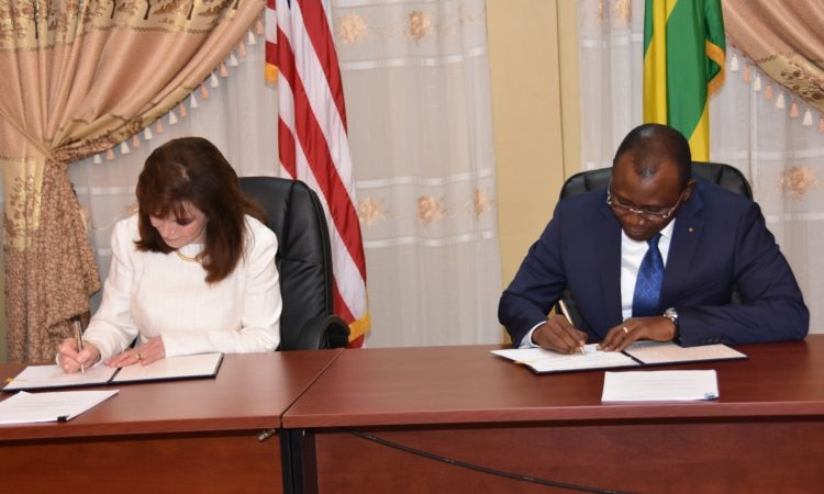 Cynthia Huger the MCC Vice President for Administration and Finance and Acting Head of Agency and Togo Minister of Economy and Finance Sani Yaya at the signing ceremony