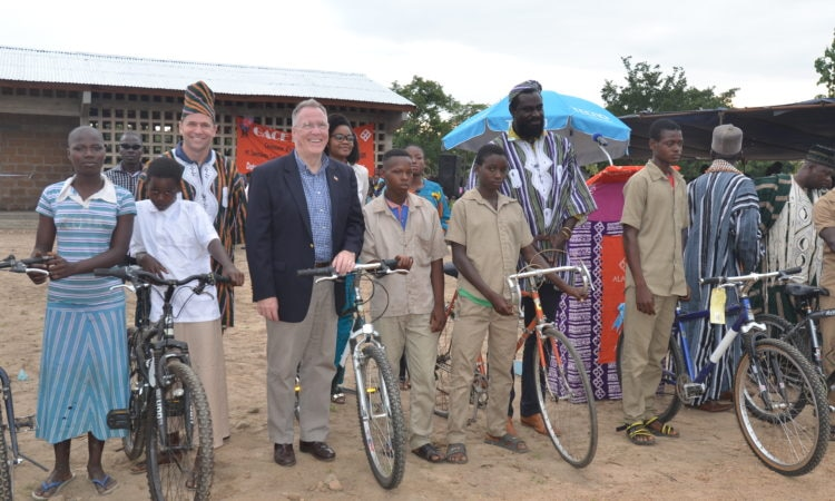 Don Clark from Whole Foods Market, U.S ambassador to Togo David Gilmour and Olowo-n'djo Tchala, founder and CEO of Alaffia, presented new bicycles to deserving students.