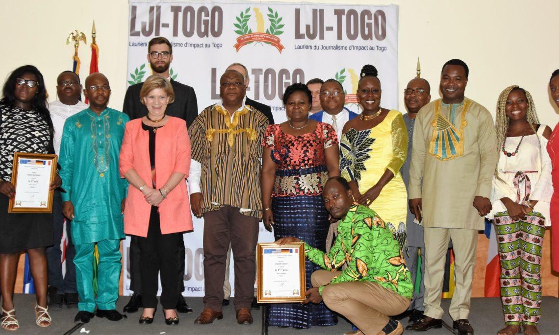 The winners posing with jury members and ambassadors